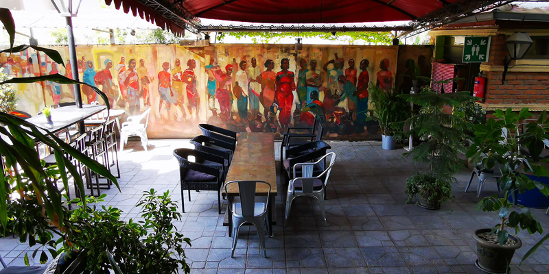Beautiful terrace with its colorful wall fresco
